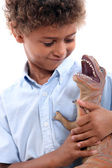 Little boy playing with a dinosaur — Stock Photo