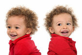 Adorable-looking twins with curly hair — Stock Photo