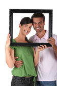 Couple behind black frame — Stock Photo
