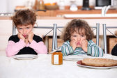 Kids pouting in the kitchen — Stock Photo