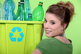 Young girl sorting plastic bottles — Stock Photo