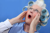 Elderly woman in shock — Stock Photo