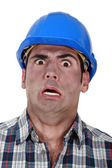 Shocked builder covered in soot — Stock Photo