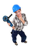 Sexy craftswoman holding an electric saw — Stock Photo