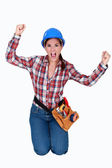 Triumphant female construction worker — Stock Photo