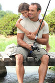 Father and son on a fishing trip — Stock Photo