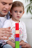Father and daughter playing with blocks — Stock Photo