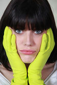 Portrait of a woman with latex glove — Stock Photo