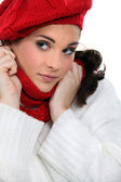 Woman wearing matching hat and scarf — Stock Photo