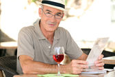 Retiree enjoying a glass of wine — Stock Photo