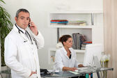 A doctor and a secretary — Stock Photo