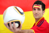 Male Spanish soccer supporter holding ball — Stock Photo