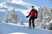 Male skier on a mountain — Stock Photo