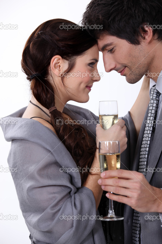 Elegant young couple drinking champagne — Stock Photo #7800035