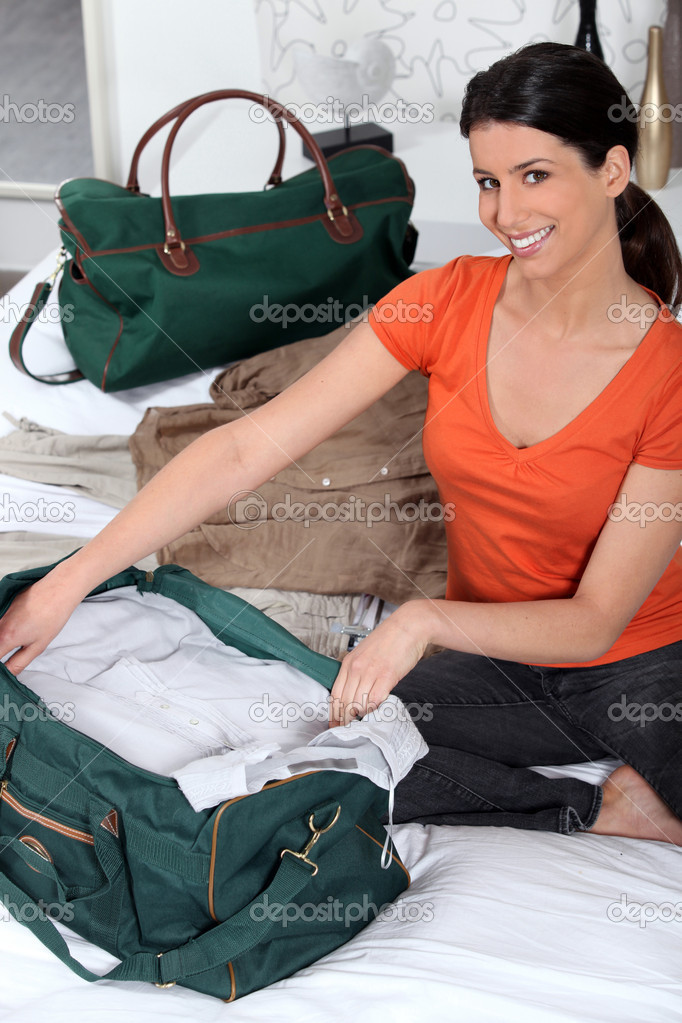 Young woman preparing travel bag — Stock Photo #7800807