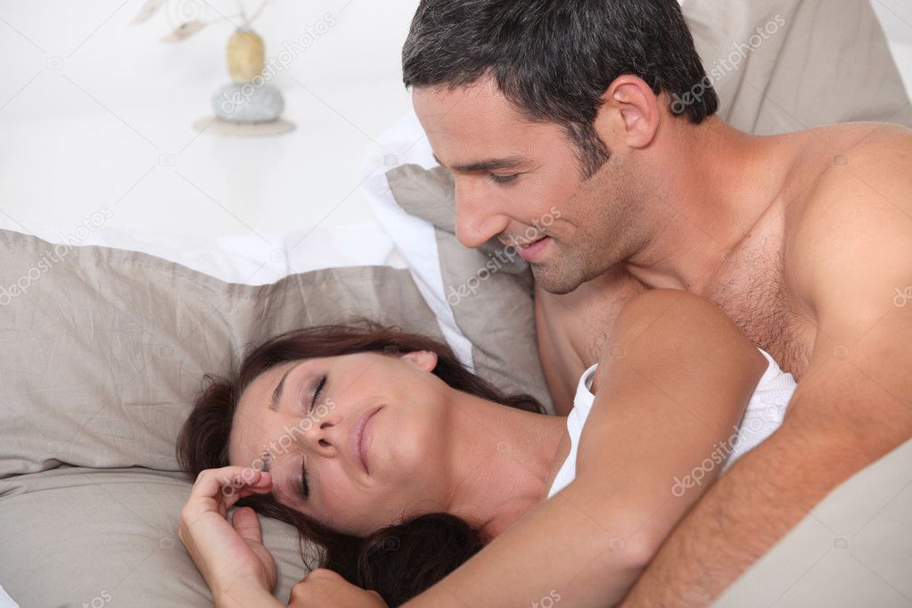 Man waking up his cranky wife  Stock Photo #7802973