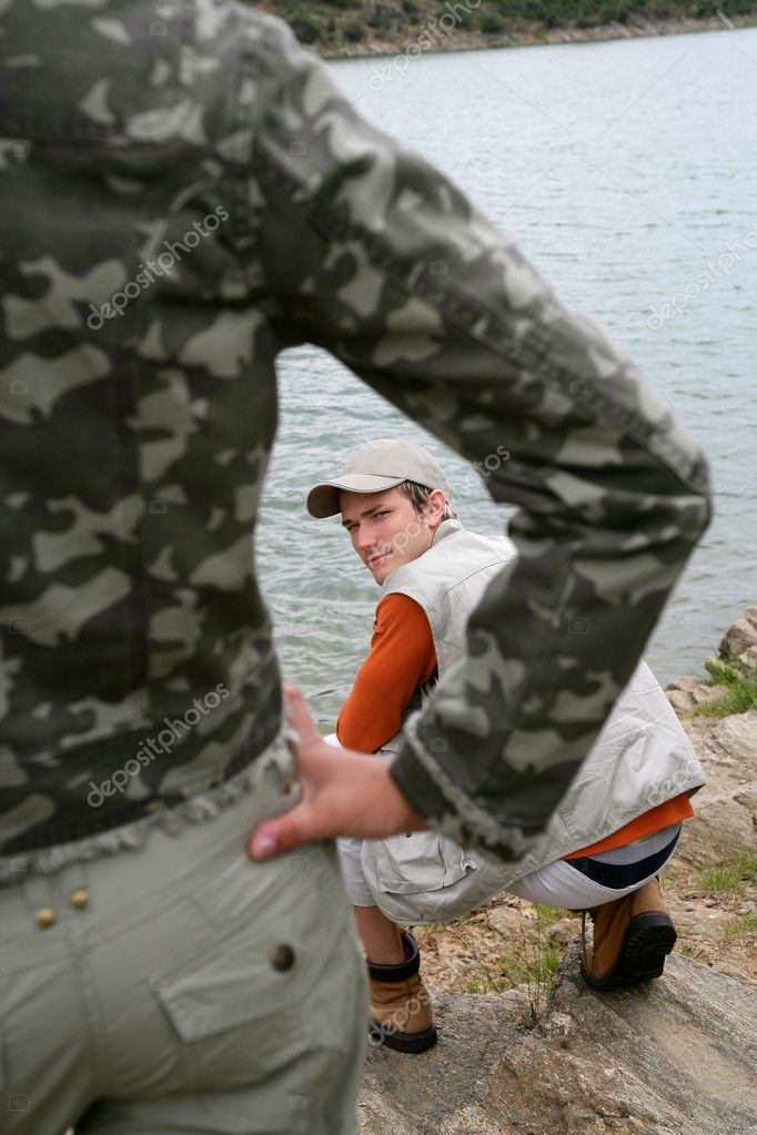 An angry confrontation by the lake — Stock Photo #7809347