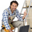 Happy laborer using computer — Stock Photo #7810664
