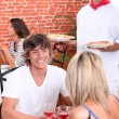 Stock Photo: Young couple on a date in a pizzeria.