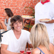 Young couple on a date in a pizzeria. — Stock Photo #7810830