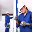 Male and female electricians working together — Stock Photo
