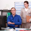 Craftsman and assistant working in the office — Stock Photo