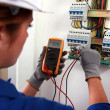 Female electrician checking a fusebox — Stock Photo #7811114