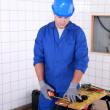 Junior plumber taking measurements — Stock Photo #7811214