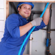 Plumber fixing some pipes — Stock Photo