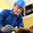 Plumber cutting grey pipe — Stock Photo