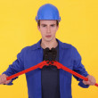 Young worker with bolt cutters — Stock Photo