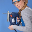 Attractive woman with band-saw — Stock Photo #7811406