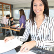 Smiling woman using a photocopier — Stock Photo