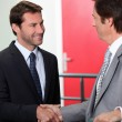 Businessmen shaking hands - Foto Stock