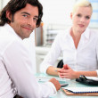 Business colleagues chatting at work — Stock Photo #7811843
