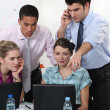 Colleagues gathered around laptop — Stock Photo #7811863