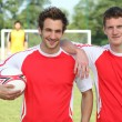 Friends playing football posing together — Stock Photo