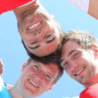 Stock Photo: Guys with heads together