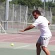 Stock Photo: Tennis player in action