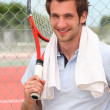 Stock Photo: Tennis player with racket