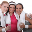 Stock Photo: Gym buddies with bottles of water