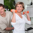 Personal trainer helping his client with her posture — Stock Photo