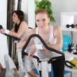 Three women working out in a gym — Stock Photo