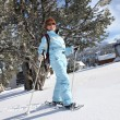 A mature woman doing snow board - Stockfoto