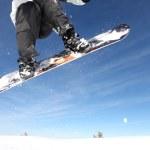 Snowboarder gliding through the air — Stock Photo