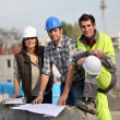 Three construction workers at site — Stock Photo
