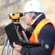 Stock Photo: Land surveyor using altometer