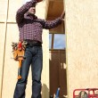 Stock Photo: Builder with a tape measure