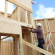 Carpenter at work in construction site - Stockfoto