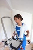 Woman redecorating house — Stock Photo